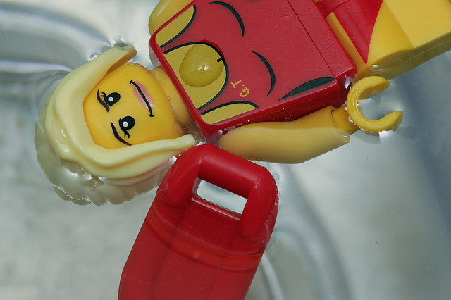 Lego toy lifeguard in swimming pool